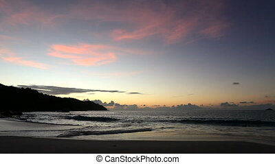 Beautiful sunset on the beach of Anse Lazio.