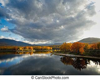 Beautiful sunset on the lake in autumn
