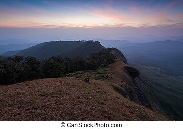 beautiful sunset on the mountain with green field at doi monjong