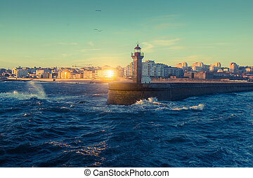 Beautiful sunset on the ocean lighthouse at coast of Porto