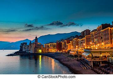 Beautiful Sunset on the Pebble Beach in Camogli near Genoa,...