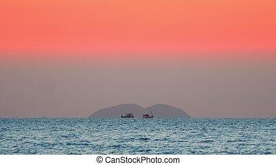 Beautiful sunset on the sea. Ships at sunset
