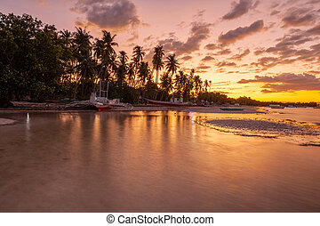 Beautiful sunset over a beach on Panglao Island, Philippines