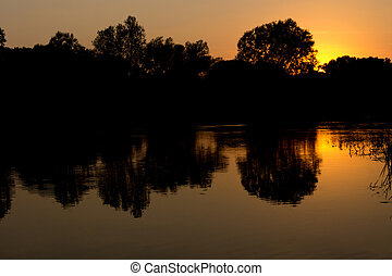 Beautiful sunset over a tranquil lake