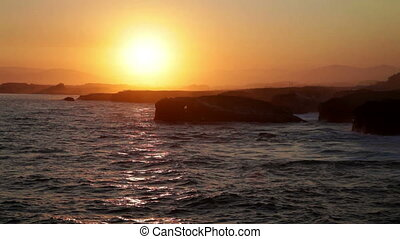 Beautiful sunset over As Catedrais beach in Spain