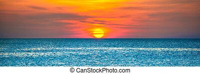 Beautiful sunset over blue sea