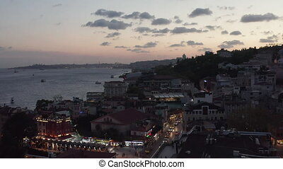 Beautiful Sunset over Istanbul Neighbourhood Ortakoy with Birds flying by and view over Bosphorus, Aerial Establishing Shot