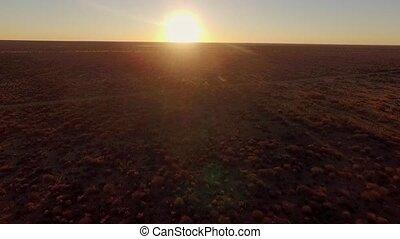 Beautiful sunset over savannah Namibia. Twilight in the...