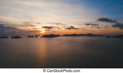 Beautiful sunset over sea, aerial view.