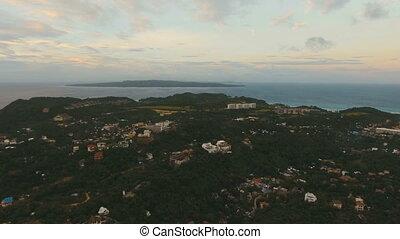 Beautiful sunset over sea, island aerial view. Boracay island Philippines.