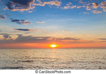 Beautiful sunset over seacoast skyline