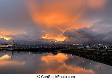 beautiful sunset over seaport dramatic landscape, Vilagarcia de Arousa, Galicia, Spain
