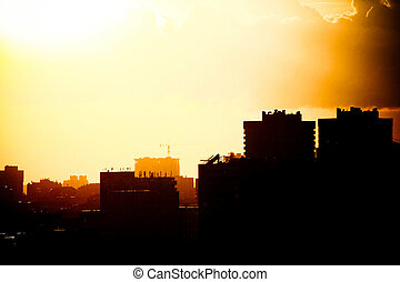 Beautiful sunset over silhouette of the city