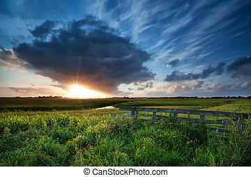beautiful sunset over summer meadows