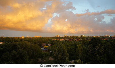 Beautiful sunset over the city, magic clouds