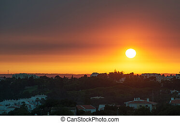 Beautiful sunset over the city of Portimao, Portugal.