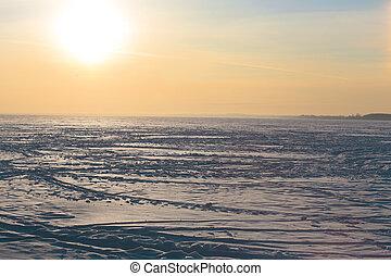 sunset over the frozen winter lake
