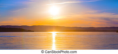 Beautiful sunset over the lake on a summer