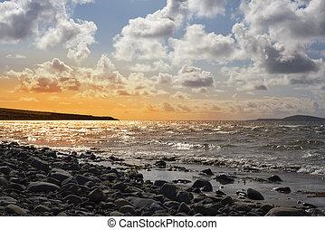 beautiful sunset over the rocky beal beach