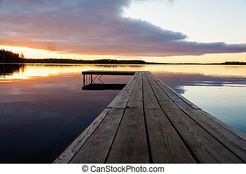 Beautiful sunset over timber jetty