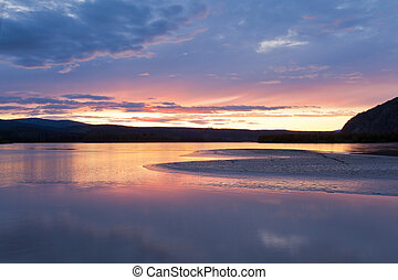 Beautiful sunset over Yukon River near Dawson City