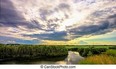 Beautiful sunset reflected on  River in Siberia during rain at forest in Russia