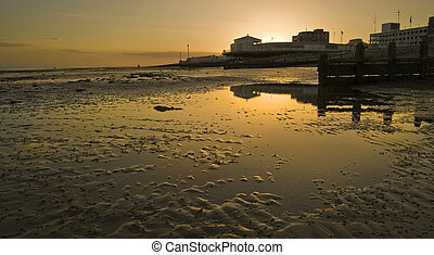 Beautiful sunset relfected in low tide sea