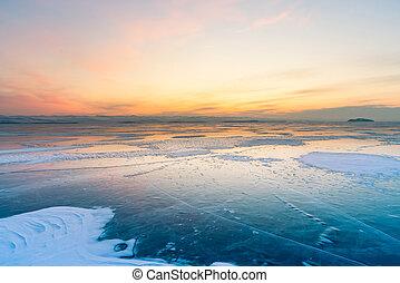 Beautiful sunset skyline over frozen water lake