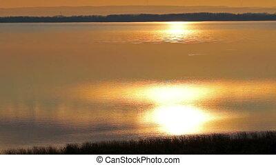 Beautiful sunset , still water
