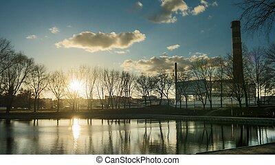 beautiful sunset sun flare water mirror reflection. time lapse lake river pond