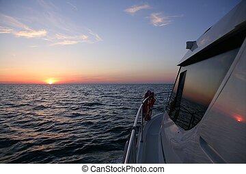 Beautiful sunset sunrise over blue sea in a yacht - Boat ...