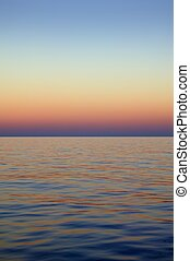 Beautiful sunset sunrise over blue sea ocean red  sky