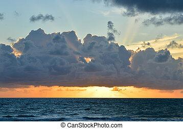 Beautiful sunset / sunrise sky with clouds