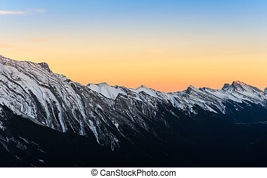 Beautiful sunset view of snow capped Rocky mountains at Banff National Park in Alberta, Canada.