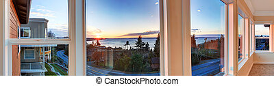 Beautiful sunset view through the windows. Panoramic picture...