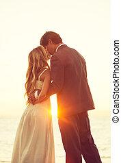 Wedding - Beautiful Sunset Wedding. Bride and Groom at...