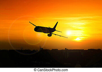Beautiful sunset with airplane