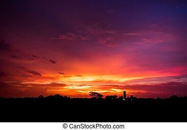 Beautiful sunset with blue sky and clouds background.