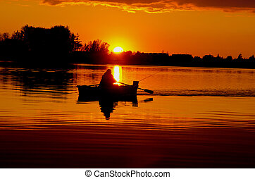 beautiful sunset with boat in the lake