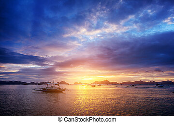Beautiful sunset with fishing boat