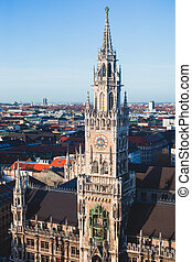 Beautiful super wide-angle sunny aerial view of Munich, Bayern, Germany with skyline and scenery beyond the city, seen from the observation deck of St. Peter Church