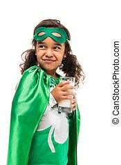 superhero girl with glass of milk