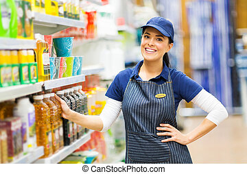 supermarket saleswoman standing in store