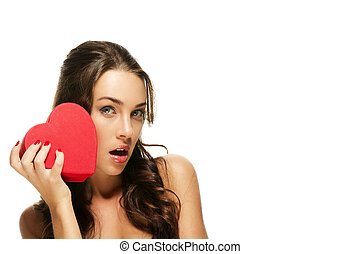 beautiful surprised woman with a red heart on white background
