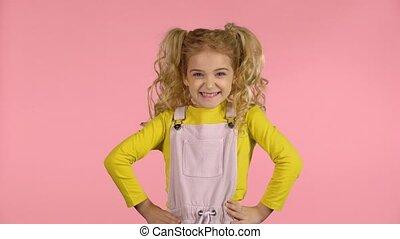 Beautiful sweet little girl feeling happy and satisfied. -...