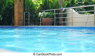 Beautiful swimming pool in villa with reflected water on...