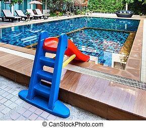 Beautiful swimming pool with tot slide.