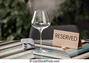 Beautiful table layout - Reserved table with empty glass and...