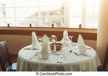 Beautiful table served with glassware and cultery, prepared for festive event. Special occasion celebrted in luxury restaurant or cafe. Table setting concept. Wedding table