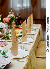 beautiful table setting for the wedding dinner in a restaurant